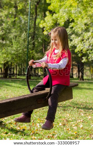 Little girl have fun in the park. Autumn season. - stock photo