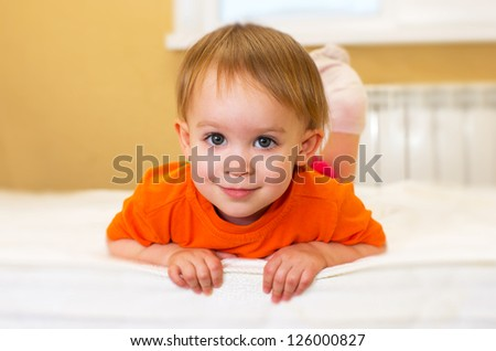 little girl have fun on bed - stock photo
