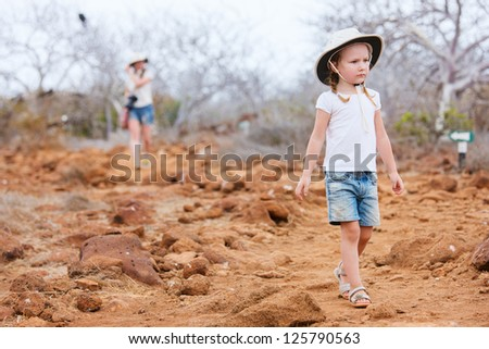 Little girl hiking at scenic terrain of North Seymour, Galapagos islands - stock photo
