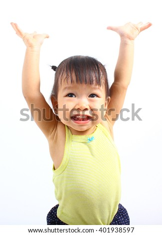 Little girl hold hands up happy isolated on a white background - stock photo