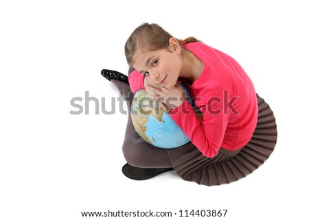 Little girl holding a globe - stock photo
