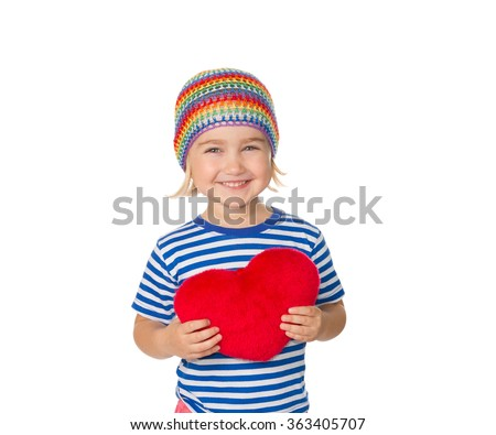 Little girl holding a red heart toy. Isolated on a white background. - stock photo
