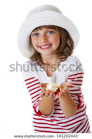 little girl holding a shell - holiday portrait - stock photo