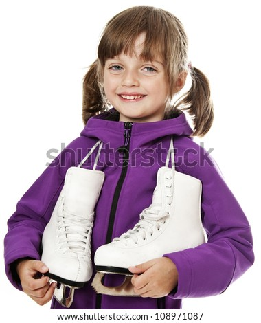 little girl holding an ice skates on white background - stock photo