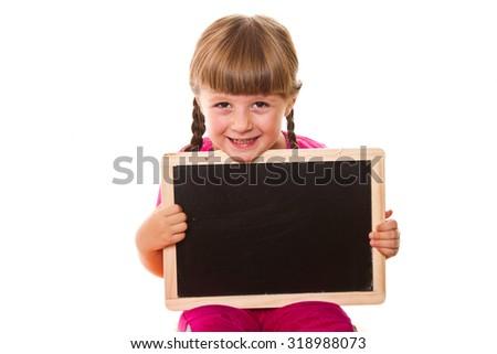 little girl holding black board on white background - stock photo