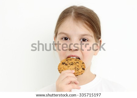 little girl holding chocolate cookie - stock photo