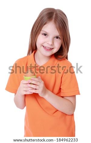 little girl holding one egg isolated over white - stock photo
