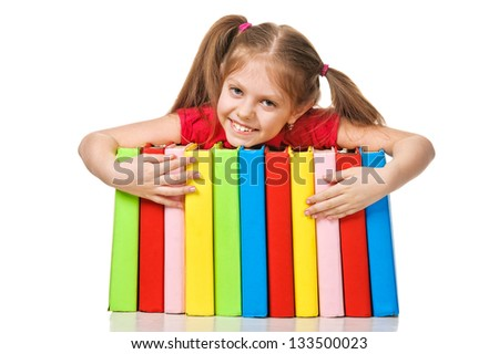 Little girl holding pile of books. Isolated over white. - stock photo