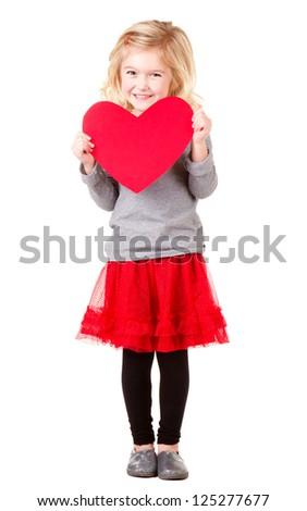 Little girl holding red heart, full length photo isolated on white - stock photo