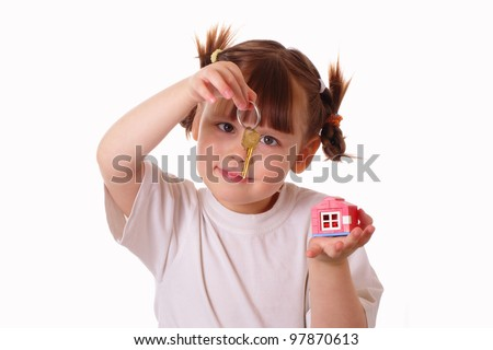 Little girl holds a key in her hand - stock photo