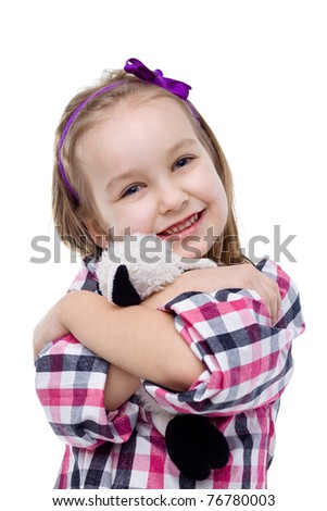 Little girl hugging her loved Teddy bear. - stock photo