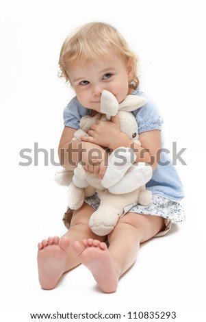 Little girl hugging her stuffed animals - stock photo
