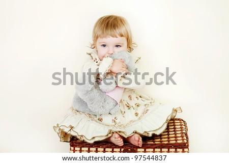 little girl hugging toy bear - stock photo