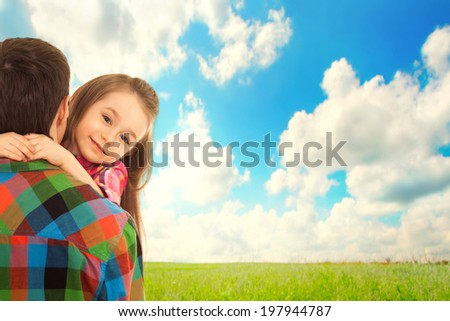 Little Girl hugs her father. Fathers day, family holiday, vacation - stock photo