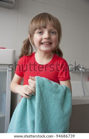 Little girl in a bathroom daily routine - washing hands - stock photo