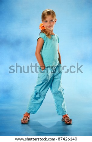little girl in a blue suit - stock photo