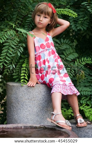 little girl in a bright dress - stock photo