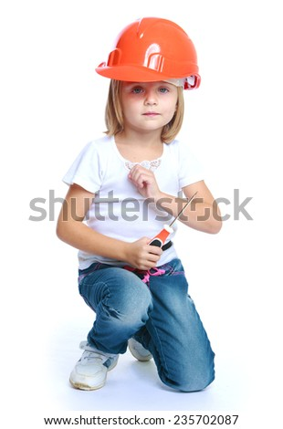 Little girl in a building helmet.Isolated on white background. - stock photo