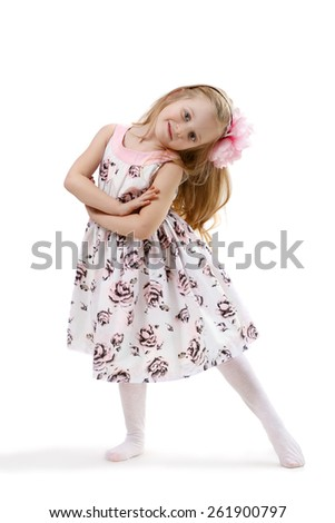 little girl in a dress dancing isolated on white background - stock photo