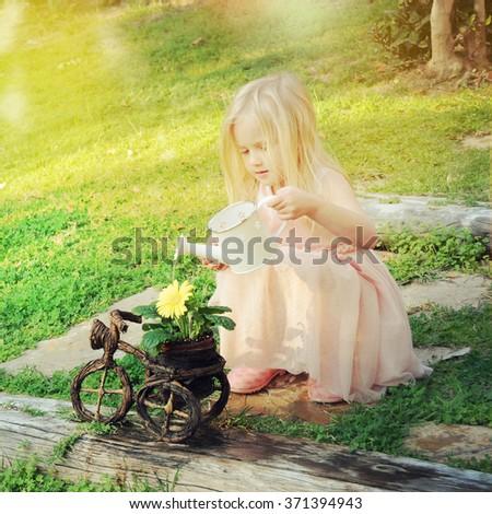 Little girl in a garden  - stock photo