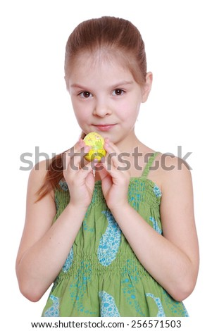 little girl in a green dress is holding easter eggs isolated on white - stock photo