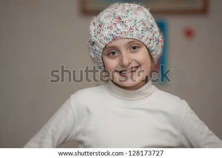 little girl in a knitted hat - stock photo
