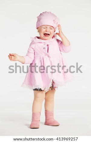 Little girl in a pink dress - stock photo