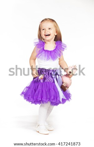 Little girl in a purple skirt - stock photo