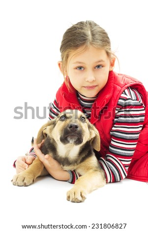 little girl in a red vest hugs his dog on a white background isolated - stock photo