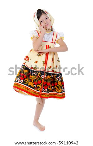 Little girl in a shawl dances. Isolated on white background - stock photo