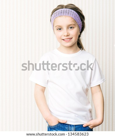 little girl in a white tshirt - stock photo