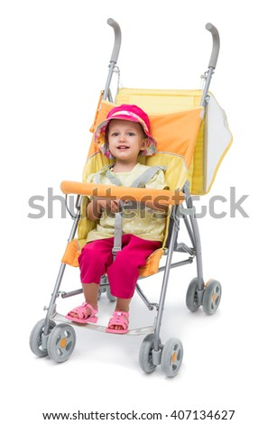 Little girl in a yellow baby carriage on a white background - stock photo