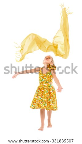 Little Girl in a Yellow Dress throws up Shawl, on white background - stock photo