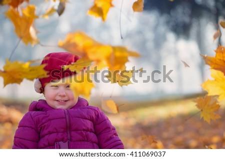 little girl in autumn park - stock photo