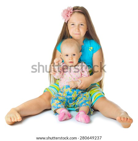 Little girl in blue dress with baby isolated - stock photo