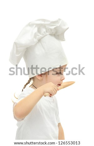 little girl in chef's hat with spoon, isolated on white - stock photo