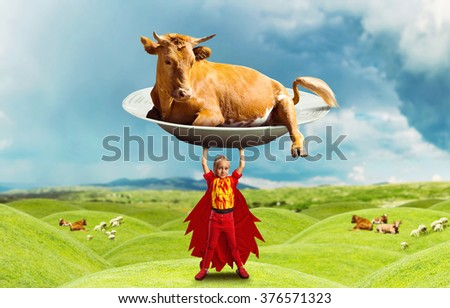 Little girl in costume holding a big cow - stock photo