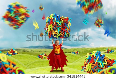 Little girl in costume holding a big cube of multicolored letters - stock photo