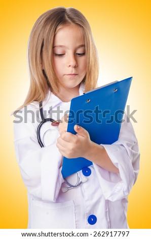 Little girl in doctor costume - stock photo