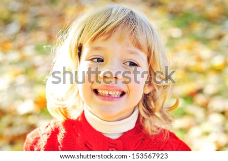 little girl in fall missing her first tooth - stock photo