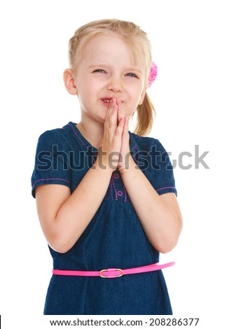 Little girl in front of a folded hands on white background.kindergarten, the concept of childhood and joy, teens - stock photo