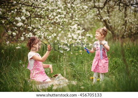 Little girl in garden - stock photo