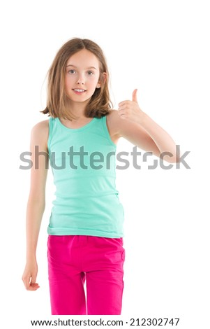 Little girl in green shirt and pink pants showing thumb up.Three quarter length studio shot isolated on white. - stock photo