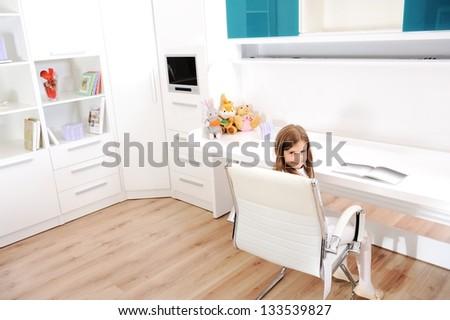 Little girl in her new room - stock photo