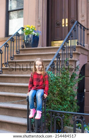 Little girl in historic district of West Village - stock photo