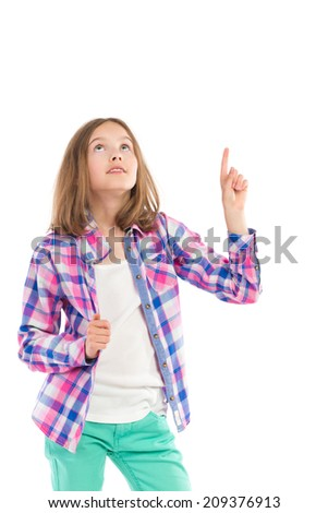 Little girl in lumberjack shirt pointing and looking up. Three quarter length studio shot isolated on white. - stock photo