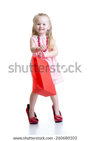 little girl in mother shoes isolated on a white background - stock photo
