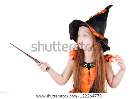 Little girl in orange costume of witch for Halloween holds wand and spell isolated on white background. - stock photo