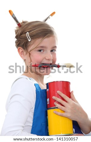 little girl in overalls painting - stock photo