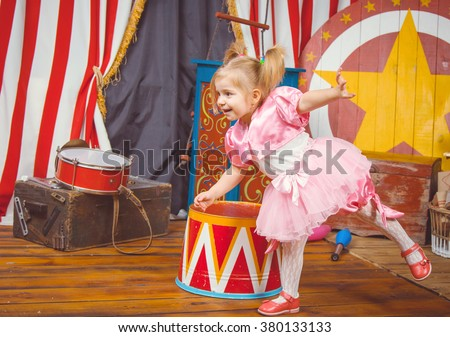 Little girl in pink costume at circus. Studio shot. - stock photo